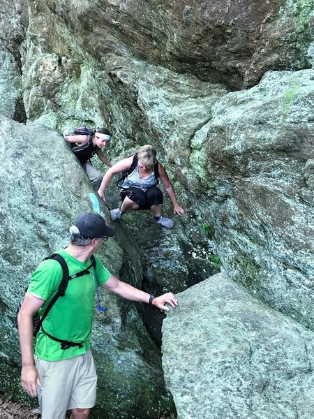 Rock Scramble coming out of Leathermans Cave.
