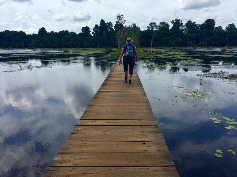 Walking the bridge to Neak Pean.