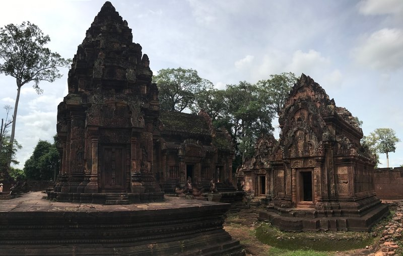 Observing the intricate carvings at Banteay Srei.