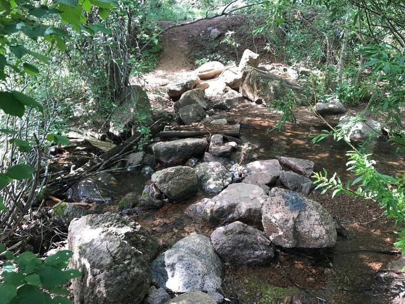 The place near Palmer Lake reservoir trailhead where you cross Monument Creek to start Chautauqua trail.