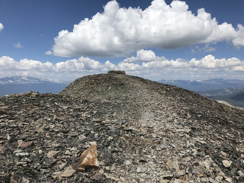 The short saddle at the top of Mount Sheridan with the windbreak at the end.