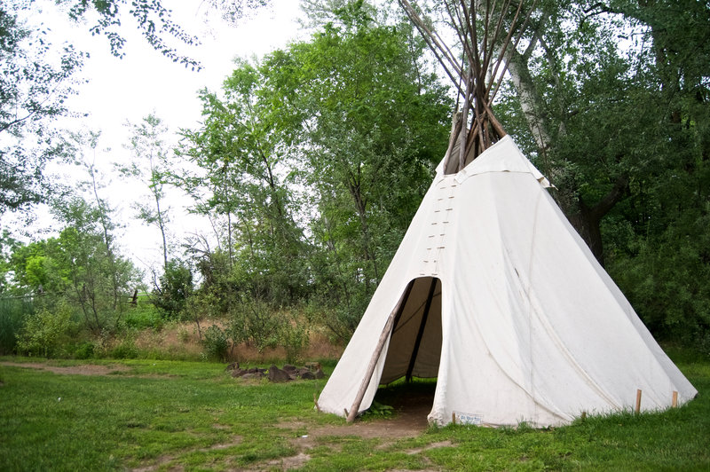A seasonal teepee can be found in a grove of trees near the creek.