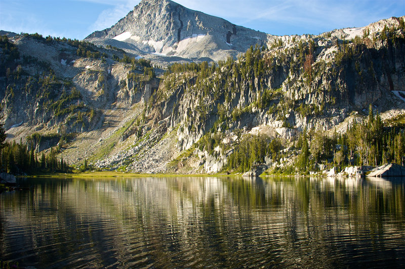 Mirror Lake reflects the craggy rocks up to Eagle Cap.