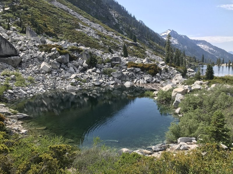 View of small lake on Upper Canyon Creek Lake outlet in Trinity Alps Wilderness