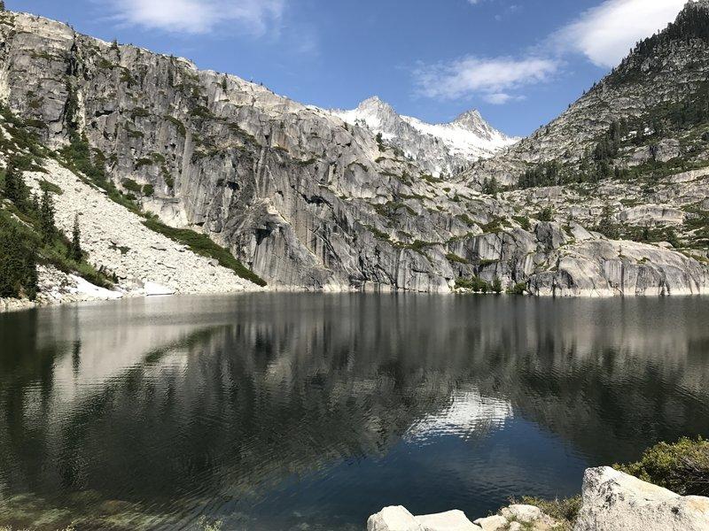 Dramatic granite headwall on Upper Canyon Creek Lake in Trinity Alps Wilderness