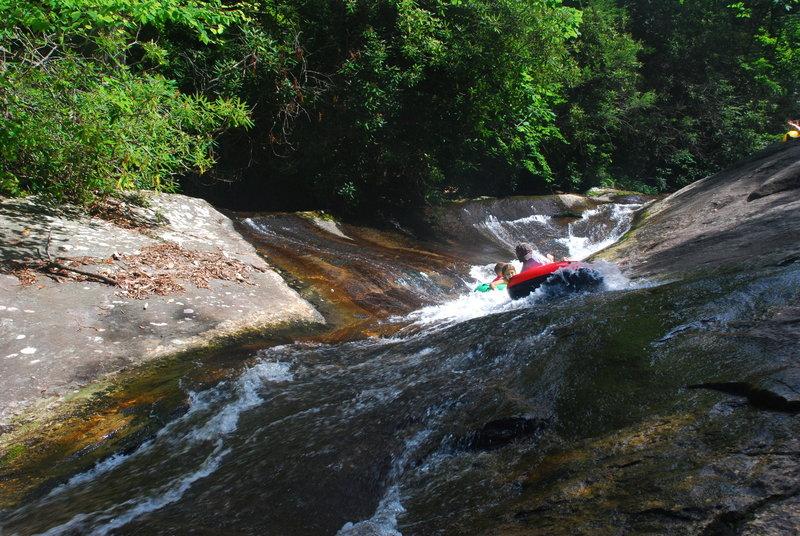 Tubers coming down the longer natural waterslide near Upper Creek Falls.