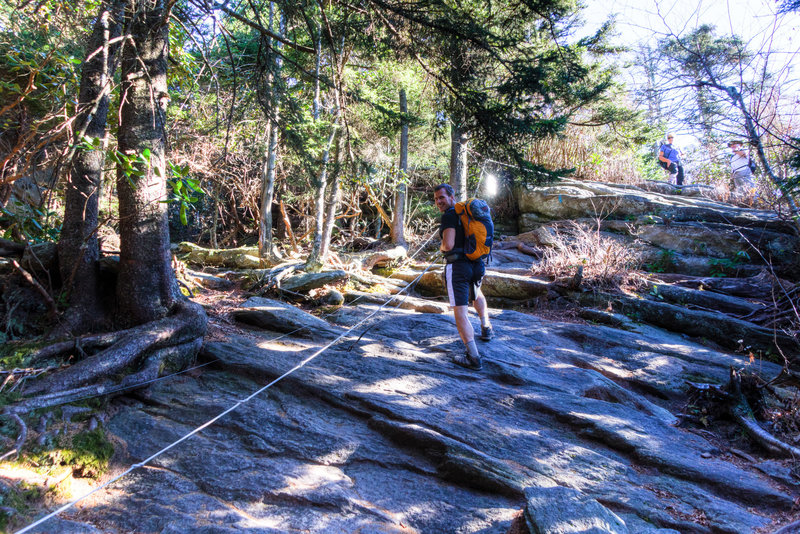 Using the anchored cables on the Grandfather Trail.