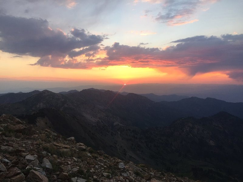 A red sunrise over the Wasatch Mountains from the ridge up toward American Fork Twin peaks
