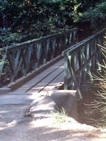 Foot bridge at Robert's Camp. Cross the bridge or head through the creek and start the climb up the paved fireroad to the Chantry Flat parking lot.