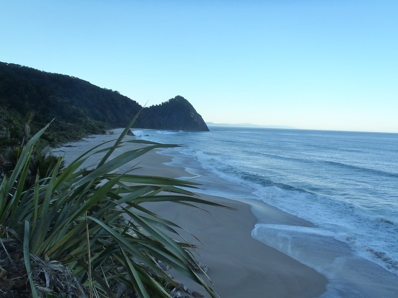 Early morning light on the sea looking back to Kohaihai Bluff at the south end of the Heaphy Track.