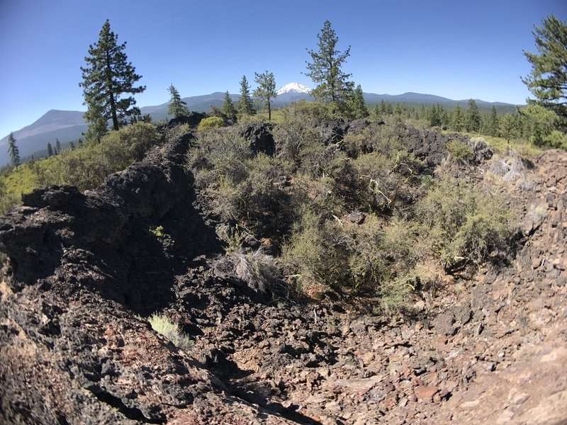View over the rim of a spattercone, looking south towards Mt. Lassen.