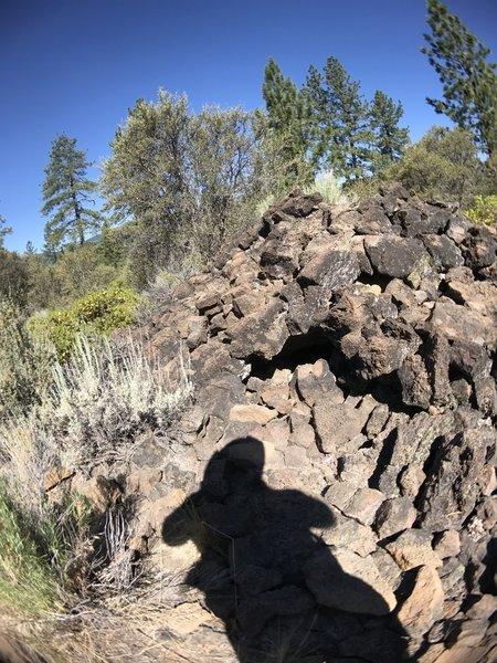 A tumulus (hollow hardened lava bubble).