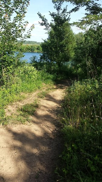 The trail has views of the lake.