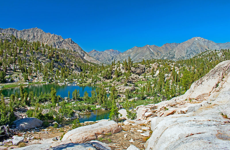 Looking north from the beginning of the gently sloping Sixty Lakes Basin Canyon. Mt. Clarence King is on the left. The mountains in the distance are on the far side of the South Fork of the Kings River and the JMT