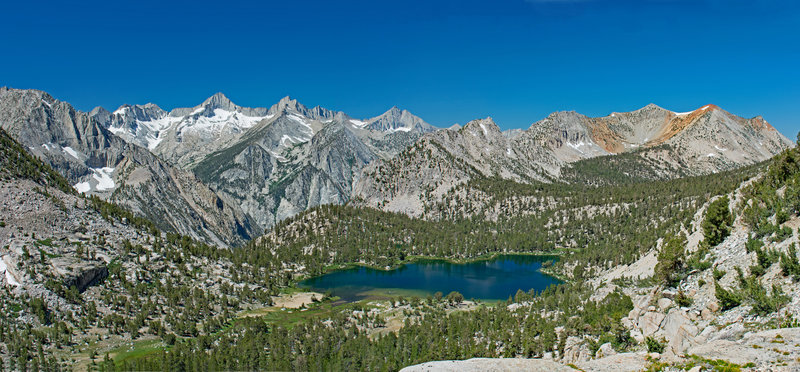 Bullfrog Lake from Kearsarge Pass Trail. You can see the cliffs of Bubbs Creek Canyon on the center with the West Vidette in the background.