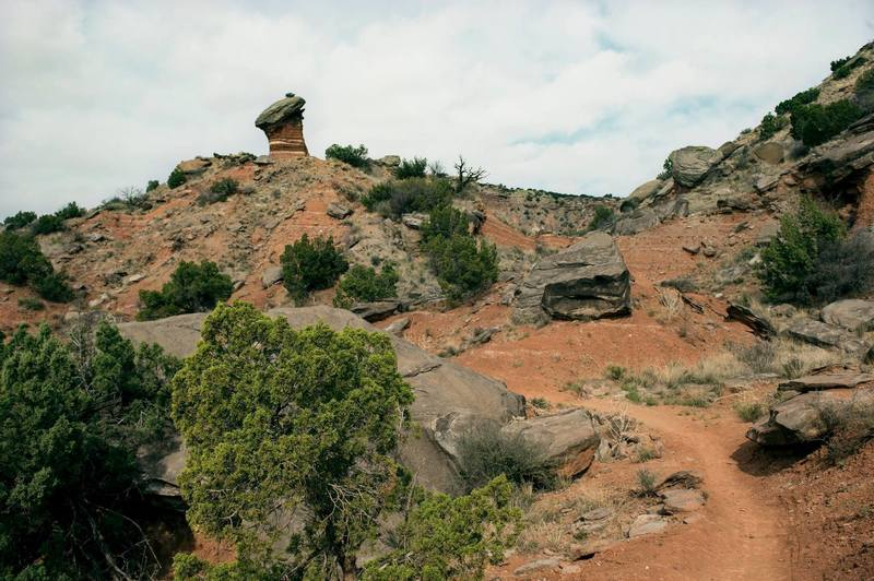 Rock formation and scrub along the Givens-Spicer-Lowry Trail.