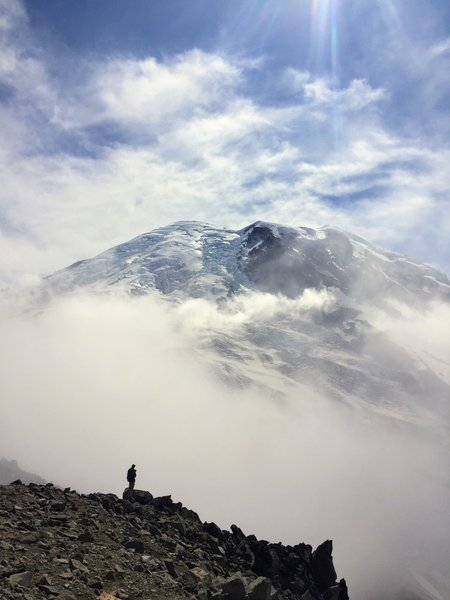 Mount Rainier peaking out from the clouds. At the top of Third Burroughs.