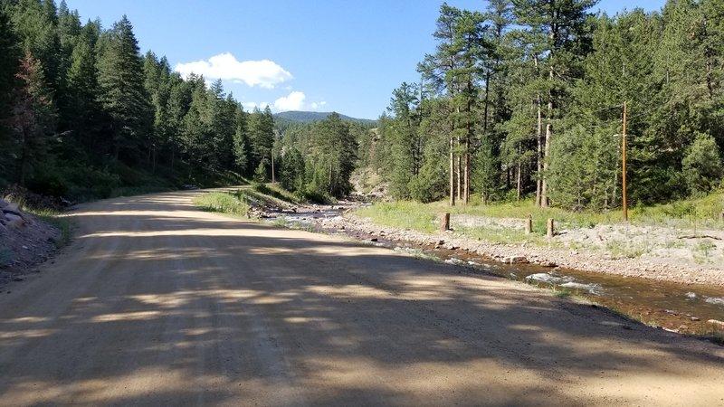 The road climbs slowly along the creek.