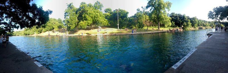 Barton Springs at Zilker Park... a small fee to get in (like 3 bucks). If you are on the Barton Creek Trail, this is a nice stop to eat lunch and take a cool dip.