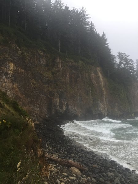 The rocky beach and majestic cliffs at the end of the Cape Meares Beach Trail