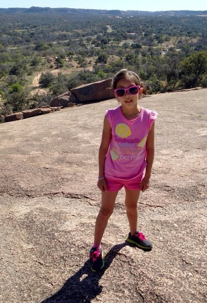 Wearing pink improves hiking moral! Lots of sun and leg work on the open rock flats to the summit.