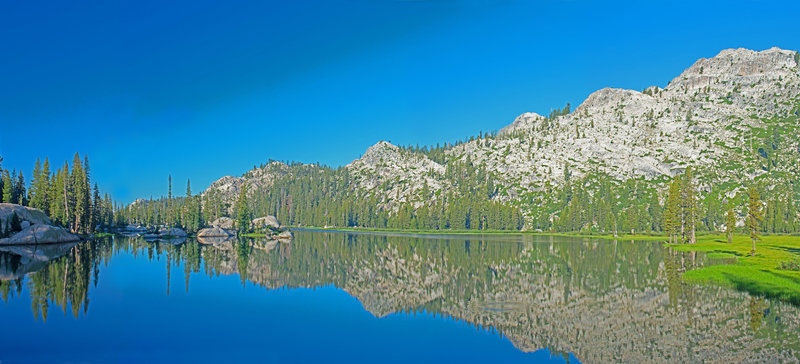 Upper Buck Lake is grassy and shallow on the west and north ends, but has rocky inlets and good campsites on the eastern side.