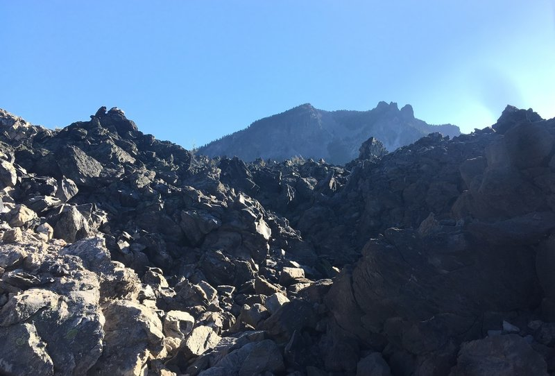 Obsidian, with peak in background.