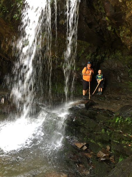 Standing behind Grotto Falls with my son.