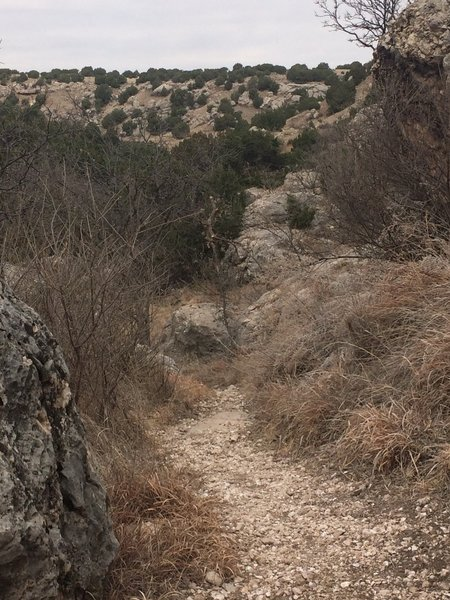 Navigate through the boulders of Quartz Rock Canyon.