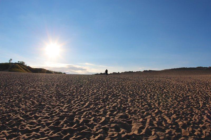 Climbing on sand dunes.