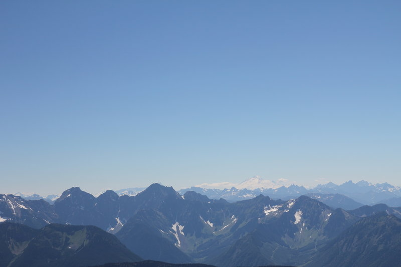 From Summit of Mount Outram: Mount Baker with Mount Slesse and Rexford to the right, and Mount Rideout and Payne to the left