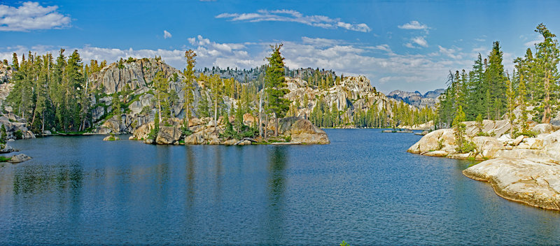 Letora Lake, with its polished granite islands and inlets that extend beyond the picture, is well worth a day's exploring, swimming, and resting.