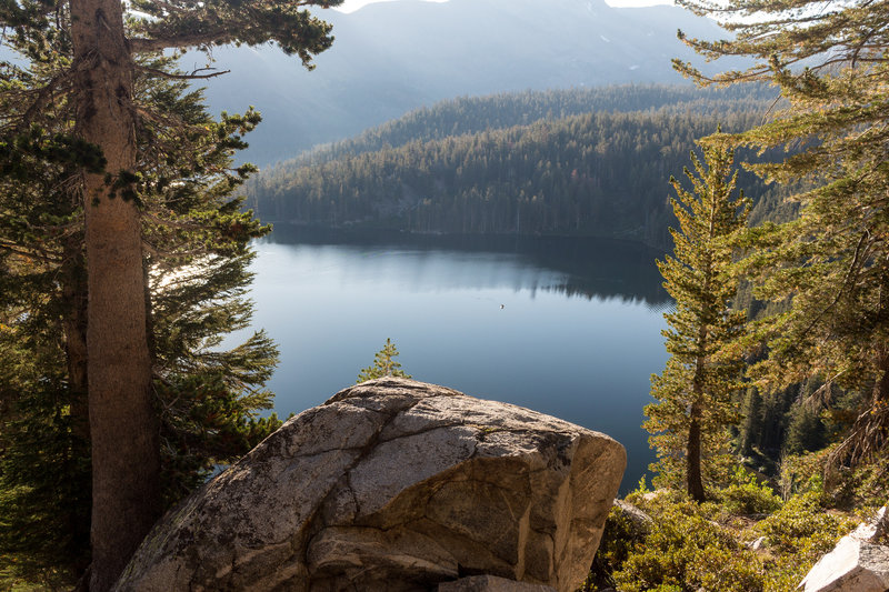 Lake George through the trees on Mammoth Crest Trail.