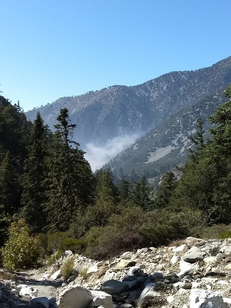 Trail view of the fog rolling into the canyon on Icehouse