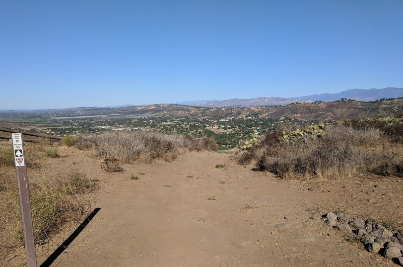 Looking northwest from a high point of the trail. Santa Rosa Valley is ahead and the mountains of northern Ventura County are in the distance.