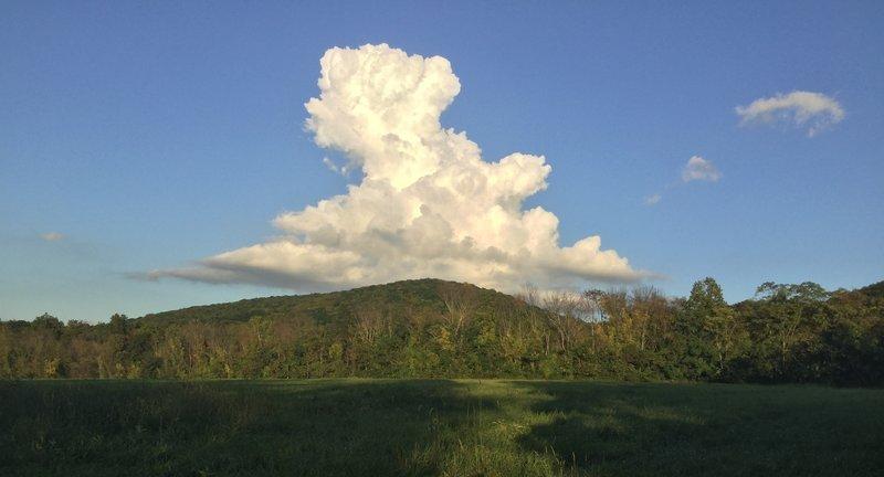 Snow white cloud over mountain.