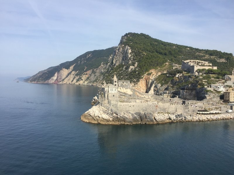 Stunning views looking back on Porto Venere (San Pietro church at center and Castello Doria on the hill at right) and up towards the Cinque Terre