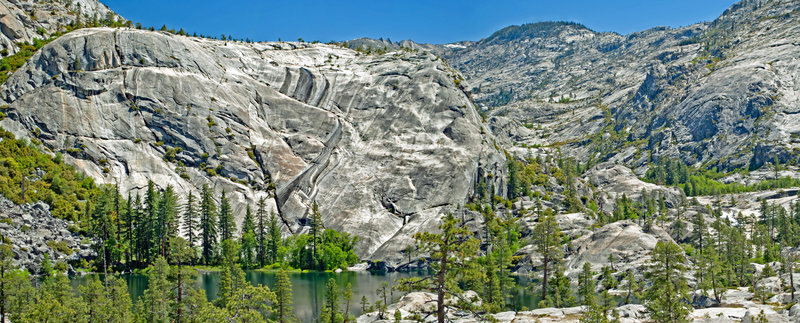 Spectacular Lake 5774. From here it does not look difficult to climb up the canyon towards Edith Lake, but with polished granite even an 8 foot cliff can stop non-rock climbers and avoiding cliffs leads to thick, deep brush.