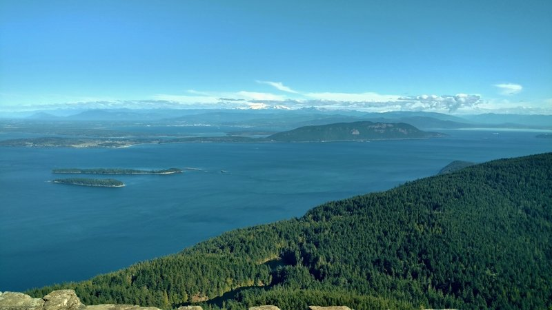 View looking east-northeast, San Juan Islands with Mt Baker in the center in the distance.