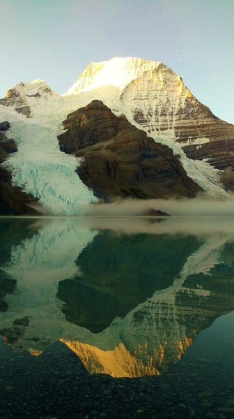 Mt. Robson reflecting into Berg Lake on a clear, still morning