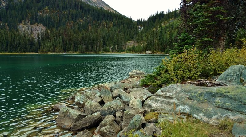The blue-green waters of the first Geraldine Lake and the waterfall at its far end.