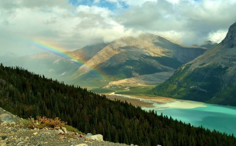 Rainbow over the valley of Berg Lake Trail. Berg Lake (front left), shoulder of Rearguard Mountain (left), and Tatei Ridge in the distance (center). Looking east from the Hargreaves Lake and Glacier Viewpoint.