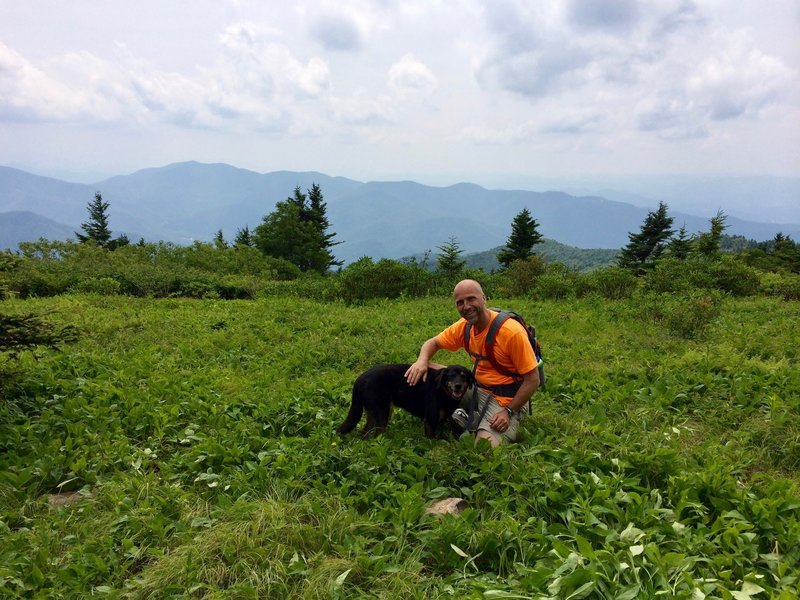 This is the meadow at the top. And this is Bodhi. He is not our dog; he was a dog from the neighborhood who led us up the trail. At one point he surprised us at the other end of a crawl through space.