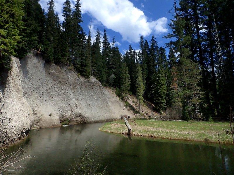 Pumice cliffs above a quiet reach of the Upper Rogue River.