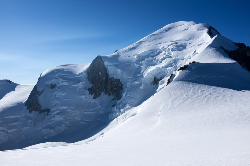 Looking up at the summit of Mt. Blanc. The Bosses Ridge is on the right, with the Vallot Hut at the base of it.