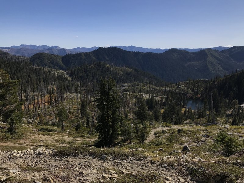 View from Haypress Trail looking east down on Monument Lake with Pacific Crest in far background
