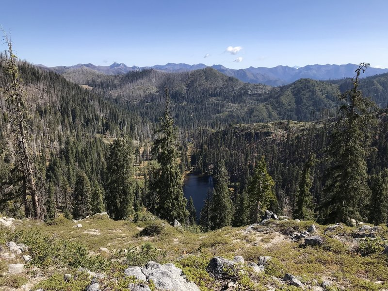 View of Meteor Lake from Haypress Trail with Marble Mountain and Pacific Crest in the background.