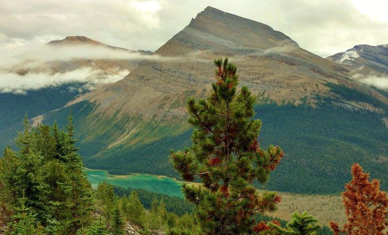 Titkana Peak with beautiful, bluegreen Adolphus Lake far below, looking east-southeast from high on Mumm Basin Route