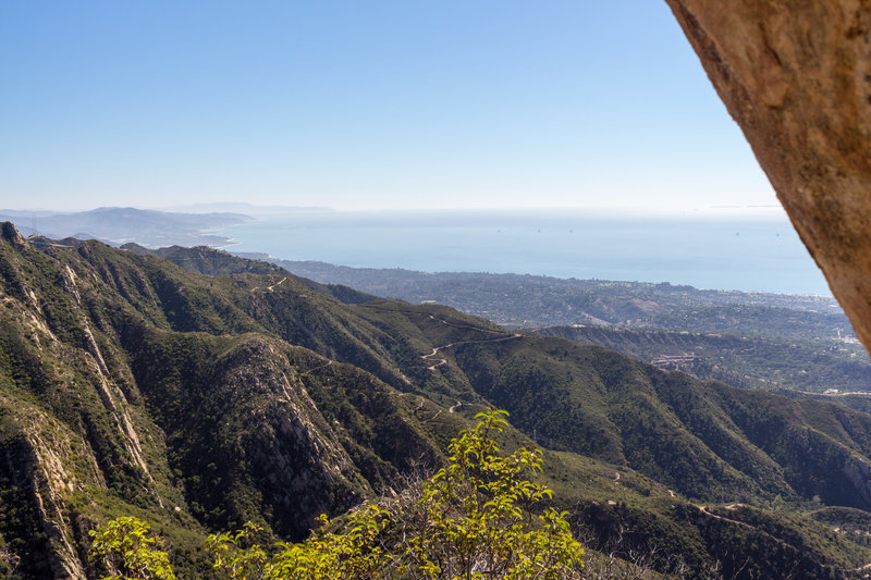 Taking a breath from the steep ascent on Cathedral Peak Trail offers stunning views of the coastal area.