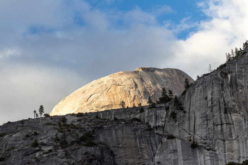 The top of Half Dome during sunset
